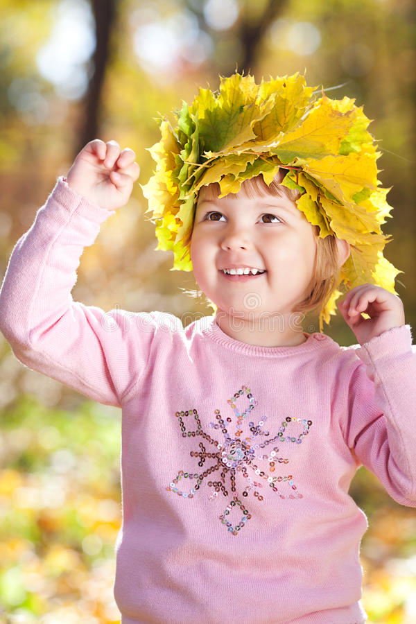 Download Little Girl In A Wreath Of Maple Leaves Stock Photo - Image: 26807326