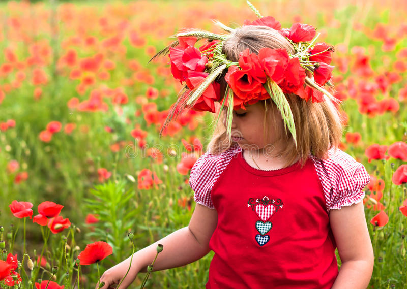 Download Little Girl In A Wreath From Poppies Stock Photo - Image of summer, ncultivated: 25224788