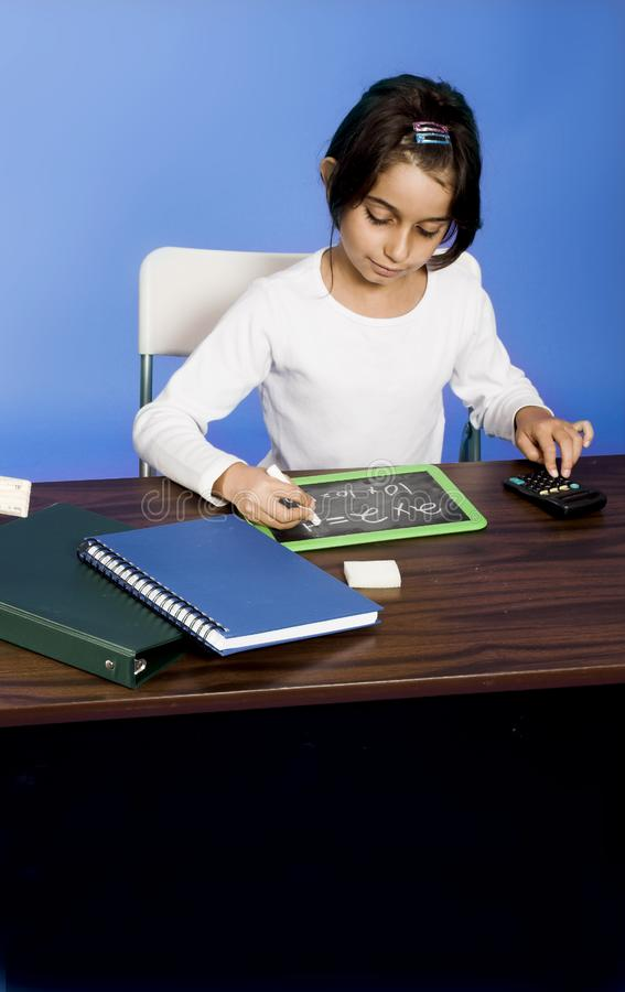 Little girl writing on board royalty free stock photos