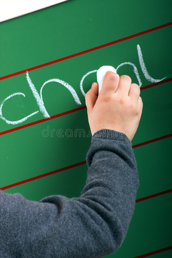 Download Little Girl Is Writing On A Board Stock Photo - Image: 7398358