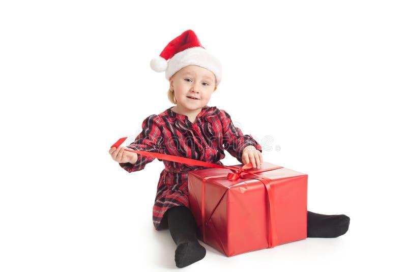 Little Girl With Xmas Gift Stock Photo