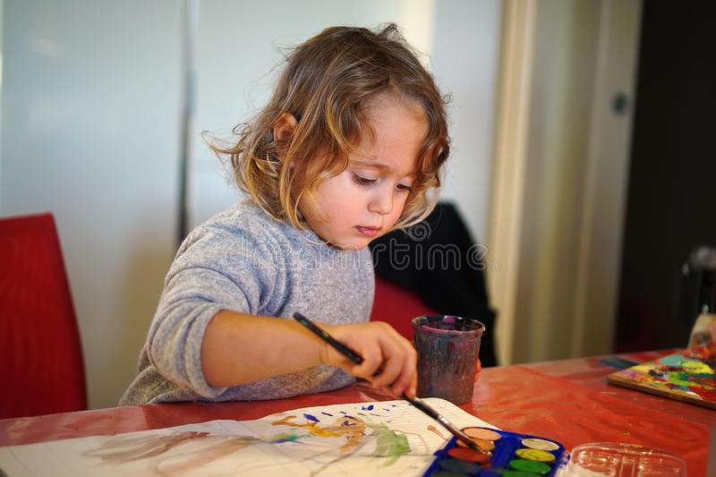 little girl paints royalty free stock photography