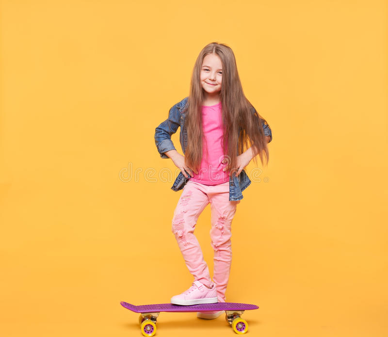 Little girl on yellow background stock images