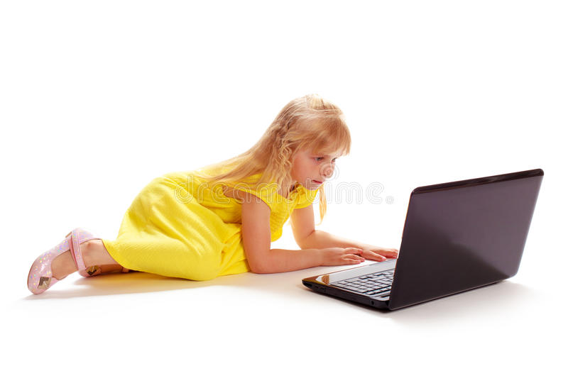 Little girl in a yellow dress stock photos
