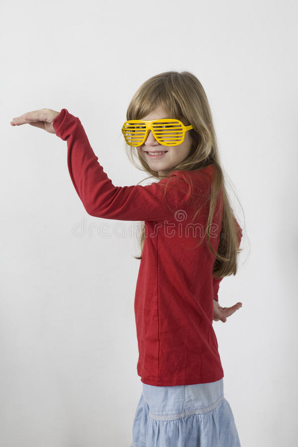 Download Little Girl In Yellow Sunglasses Dancing Royalty Free Stock Image - Image: 11797106