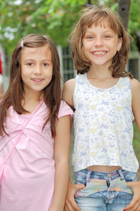 Little girlfriends stock images