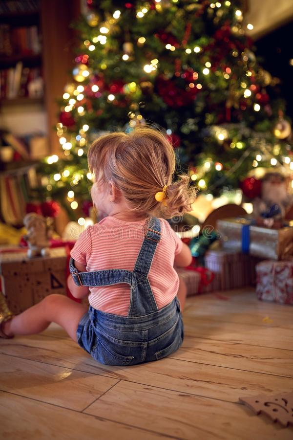 Girl open Christmas presents. Christmas magic in home. Little girlopen Christmas presents. Christmas magic in home royalty free stock images