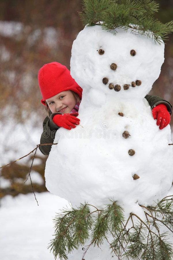 Download Little Girlposing With Snowman Stock Photo - Image of hiding, nature: 8570788
