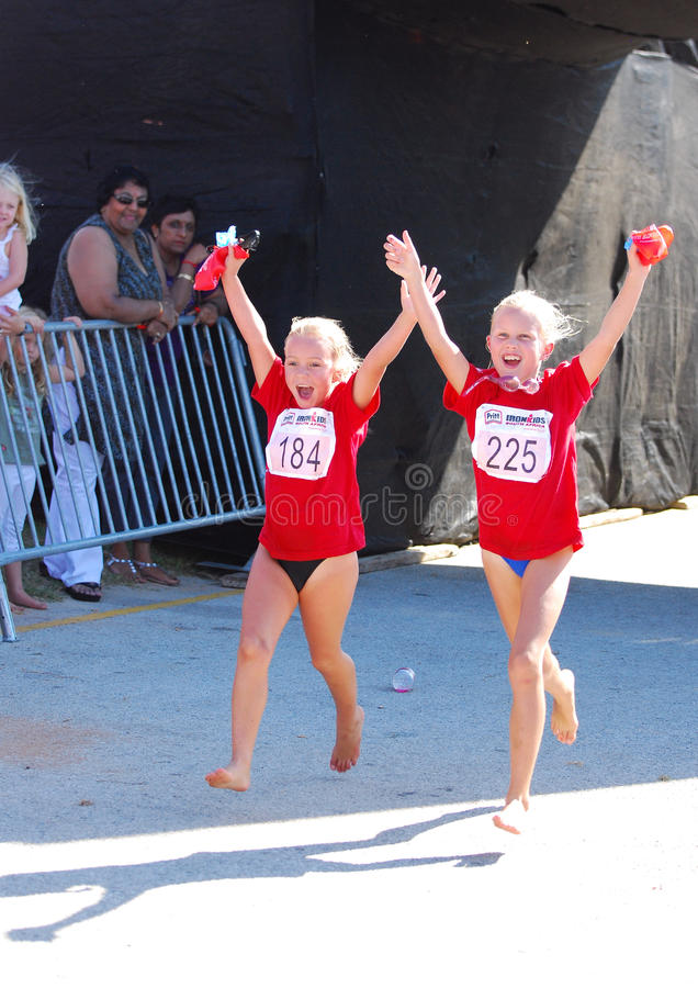 Little girls athletes running stock photo