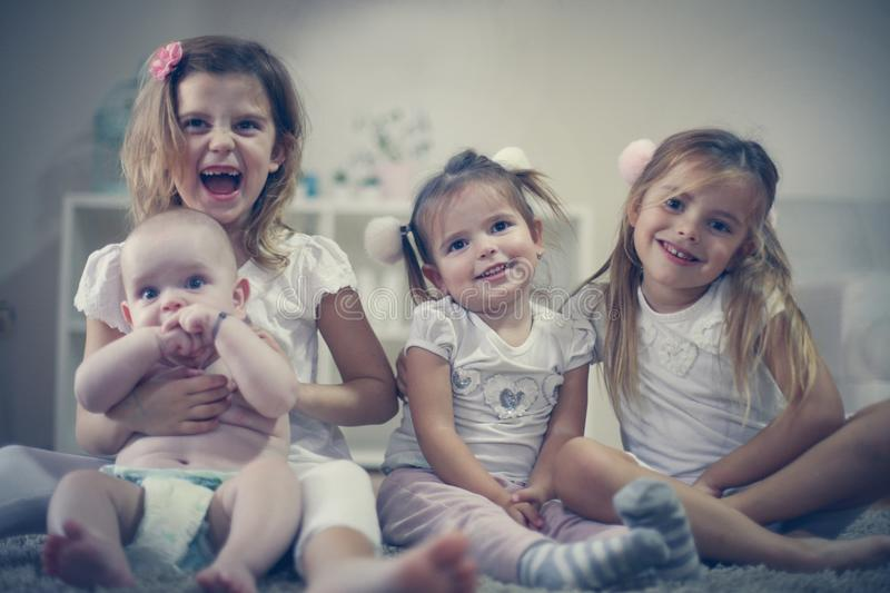 Little girls with baby brother . Portrait. royalty free stock image