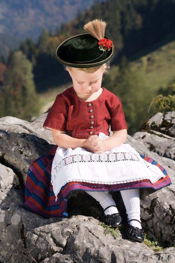 Little girls in Bavarian pray royalty free stock photography