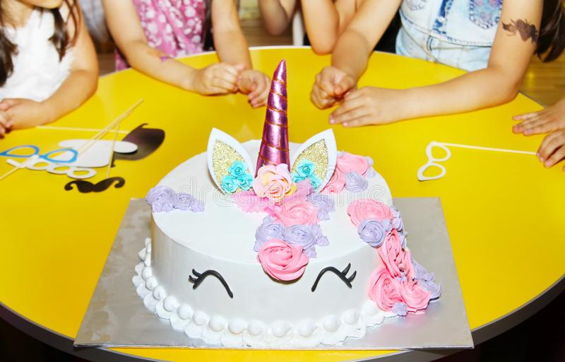 Little girls birthday party table with unicorn cake. royalty free stock photo