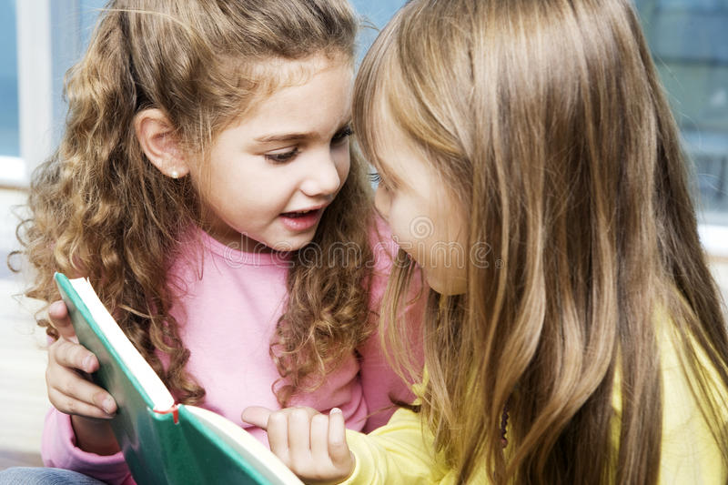 Little girls with book stock photos