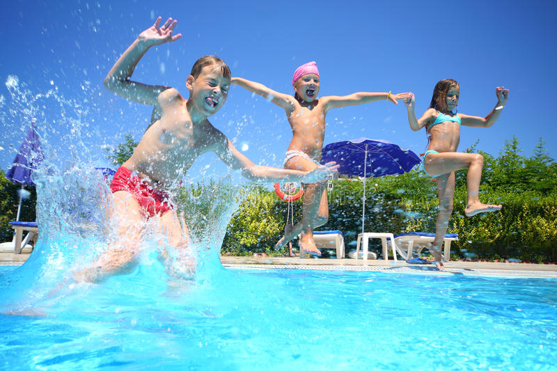 Download Little Girls And Boy Fun Jumping Into The Swimming Pool Stock Photo - Image: 32481752