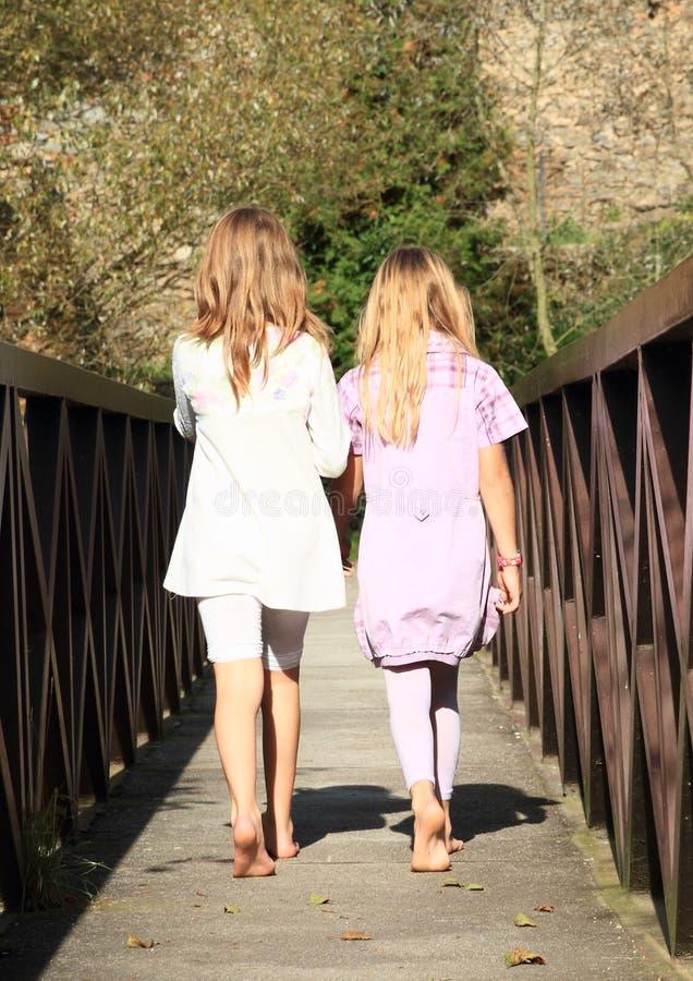 Little girls on bridge stock photo