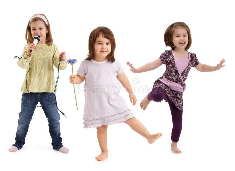 Little girls dancing having fun stock photos