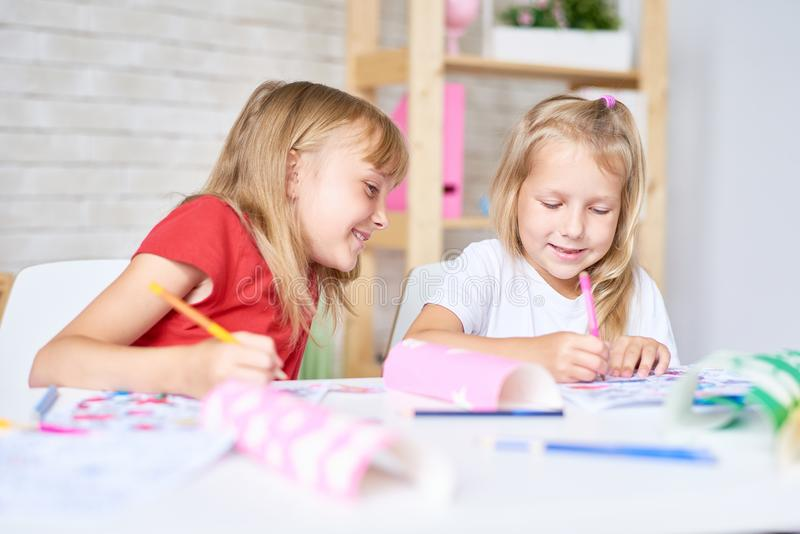 Little Girls Drawing Together royalty free stock image