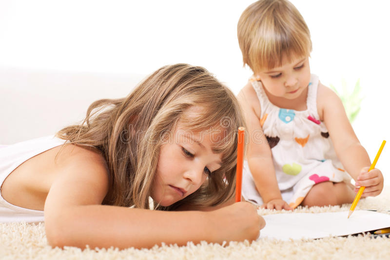 Little girls drawing stock images