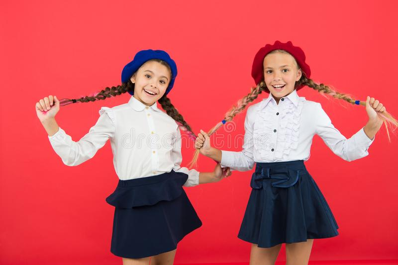 Little girls in french beret. friendship and sisterhood. best friends. Education abroad. kid fashion. International stock image