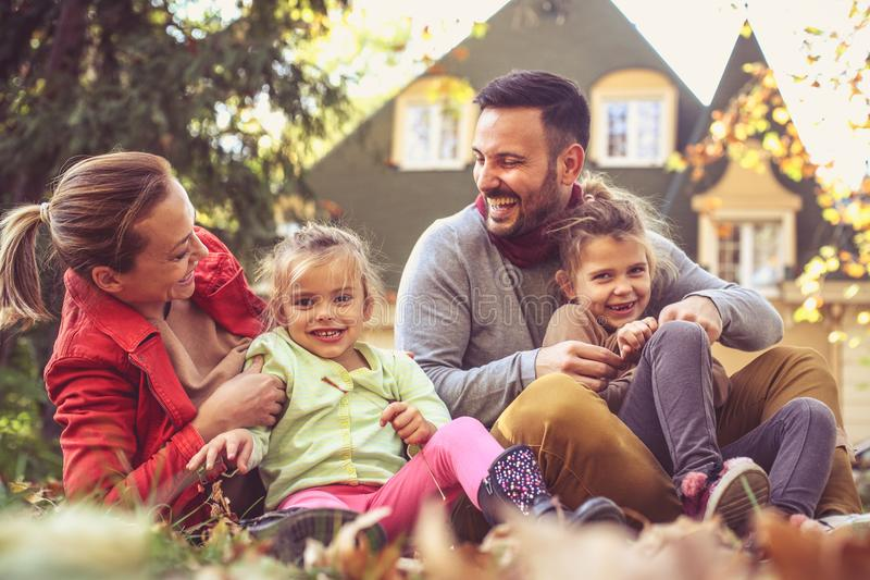 Little girls have play with parents. Girls looking at camera stock photo