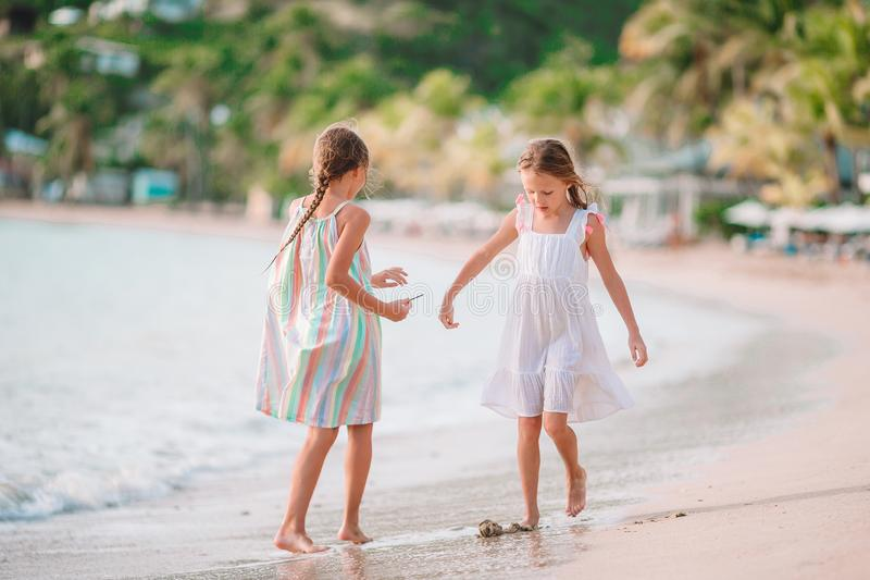 Little girls having fun enjoying vacation on tropical beach royalty free stock photos