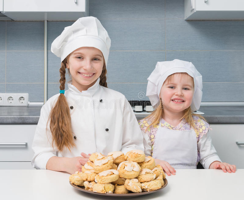 little girls holding a bowl with homemade cookies stock photography