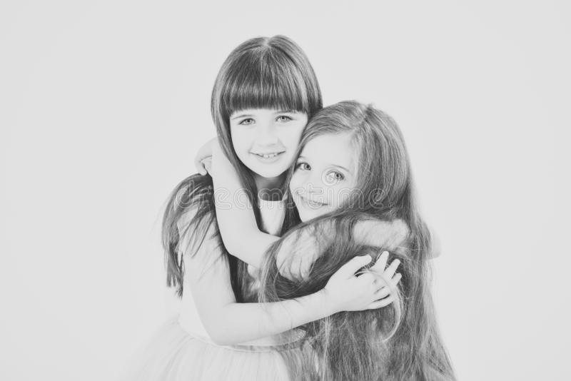 Little girls model. Wedding, summer fashion concept - two girls dressed in dress smiling hugged another royalty free stock images