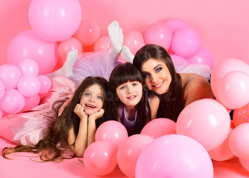 Little girls, mom in pink balloons. royalty free stock photo