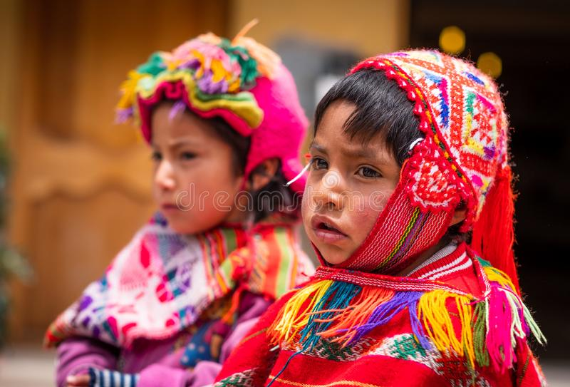 Little girls in national clothing looking, in Cusco stock image