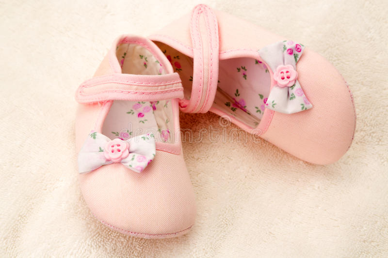 Little girls pink baby shoes royalty free stock image