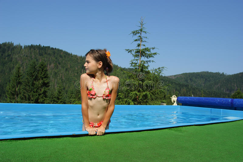 Download Little Girls Playing In The Bassin Stock Photo - Image: 25650422