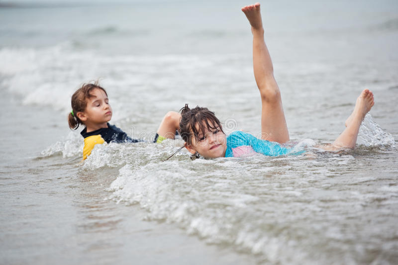 Little girls playing on the beach, family beach vacation. The Little girls playing on the beach, family beach vacation royalty free stock image