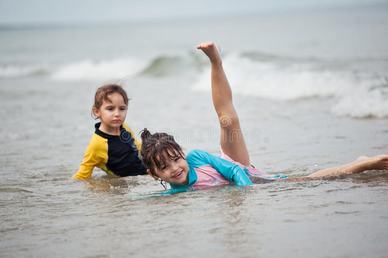 Little girls playing on the beach, family beach vacation. The Little girls playing on the beach, family beach vacation royalty free stock photos