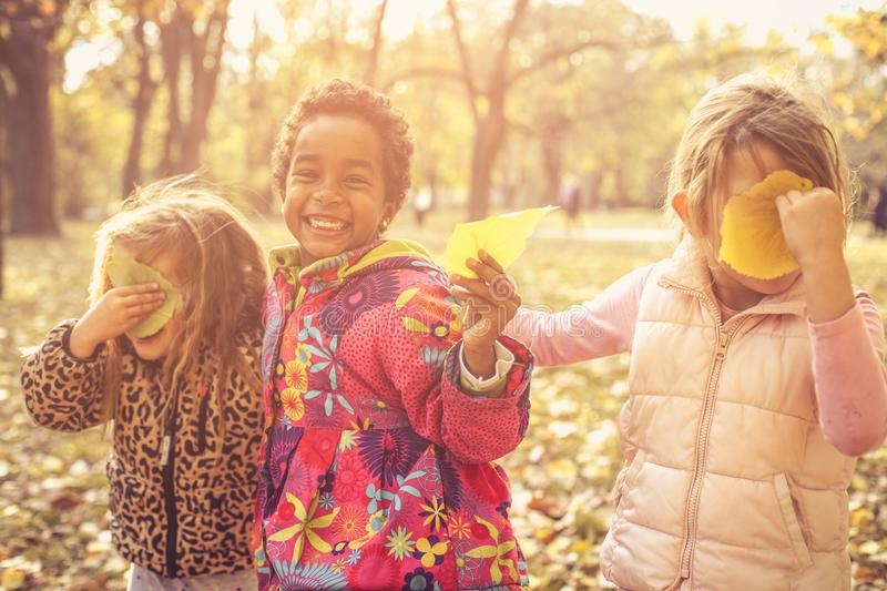 Three little girls in park. royalty free stock photo
