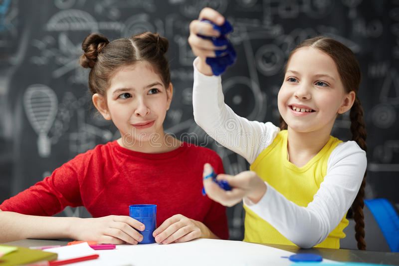 Little Girls Playing with Modelling Clay in Art Class royalty free stock image