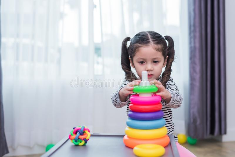Little girls playing small toy hoops in home. Education and Happiness lifestyle concept. Funny learning and Children development. Theme. Smile faces royalty free stock photo