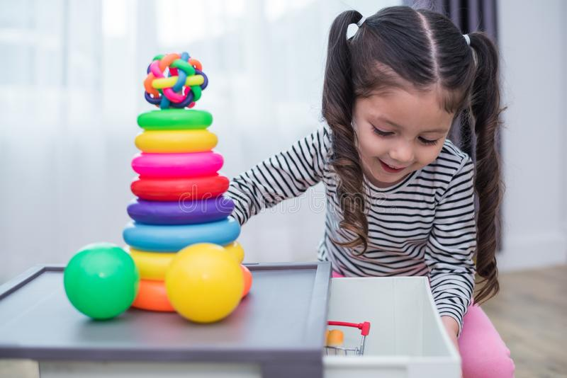 Little girls playing small toy hoops in home. Education and Happiness lifestyle concept. Funny learning and Children development. Theme. Smile faces royalty free stock images