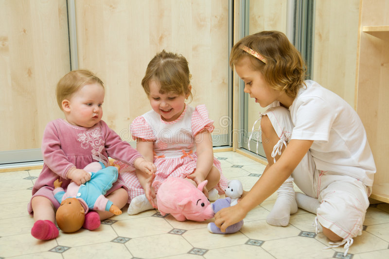 Little girls playing together royalty free stock images