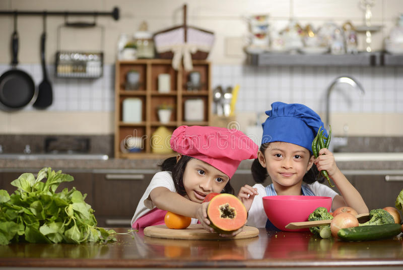 Little Girls Preparing Healthy Food royalty free stock image