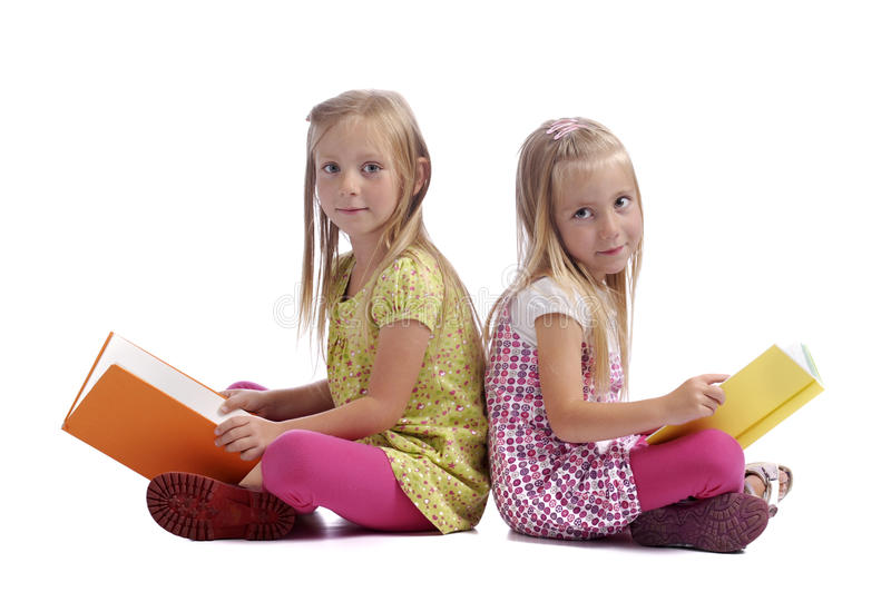Download Little girls reading books stock image. Image of blond - 20531867