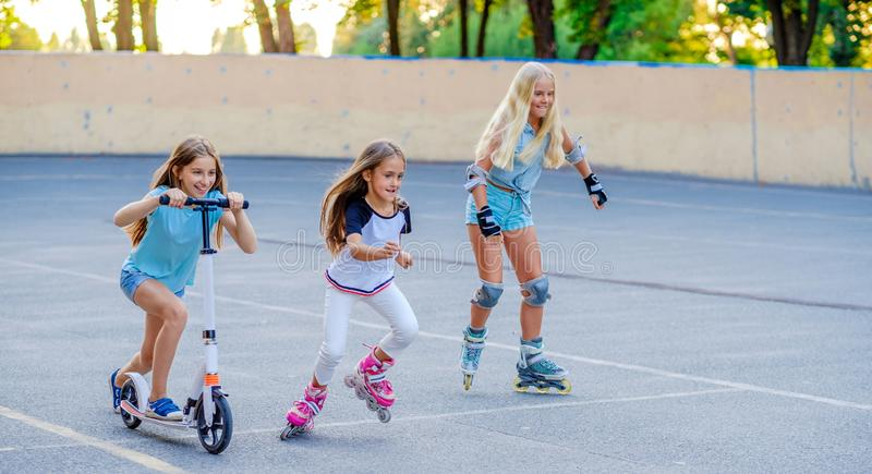 Little girls riding and competing in the skatepark royalty free stock photography