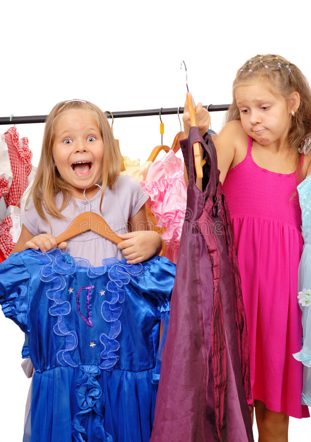 Little girls in shop of dresses. Isolated on white. Different emotions royalty free stock image