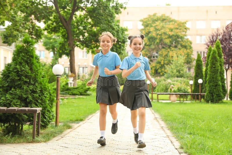 Little girls in stylish school uniform stock photos