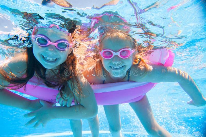 Children swim in  pool royalty free stock photo