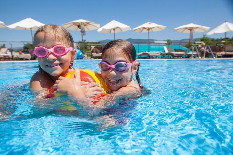 Children swim in  pool royalty free stock images