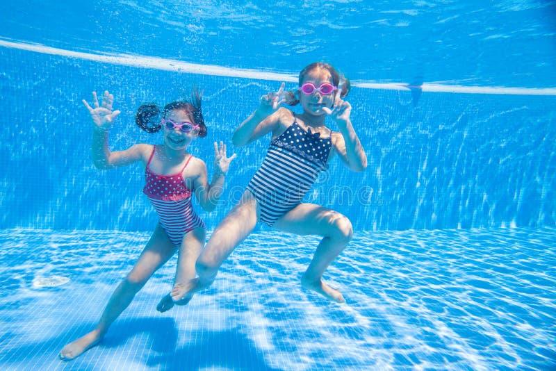 Children swim in  pool stock photography
