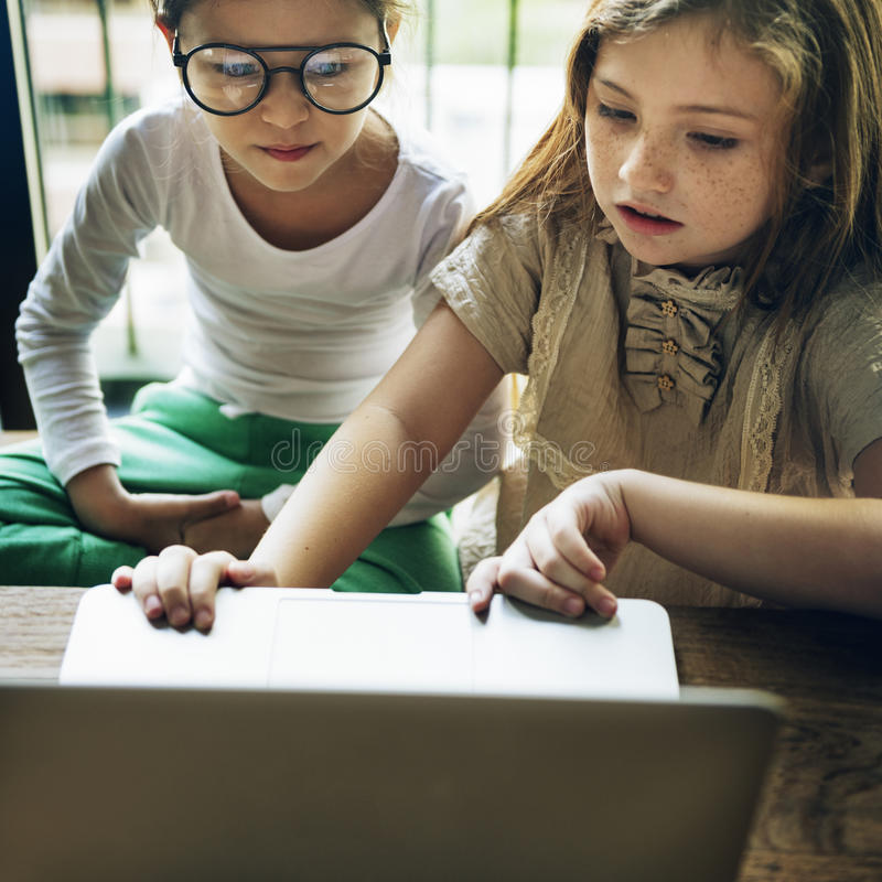 Little Girls Using Laptop Concept royalty free stock image