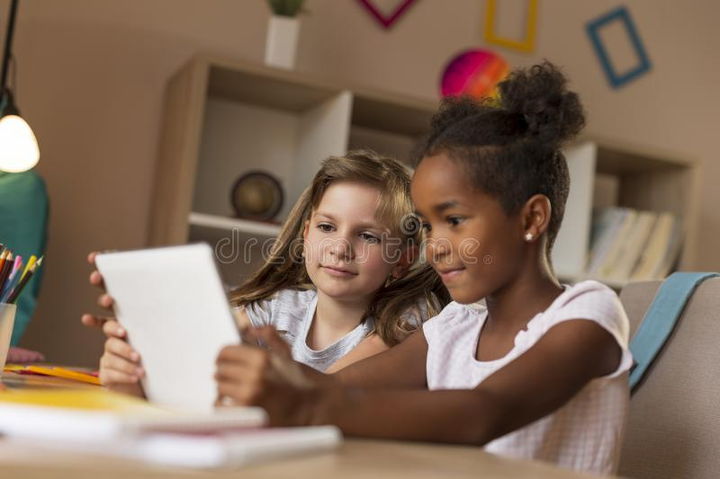 Little girls watching funny videos royalty free stock photo
