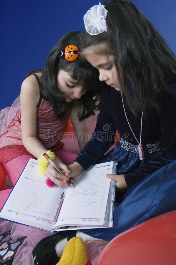 Little girls writing stock photos