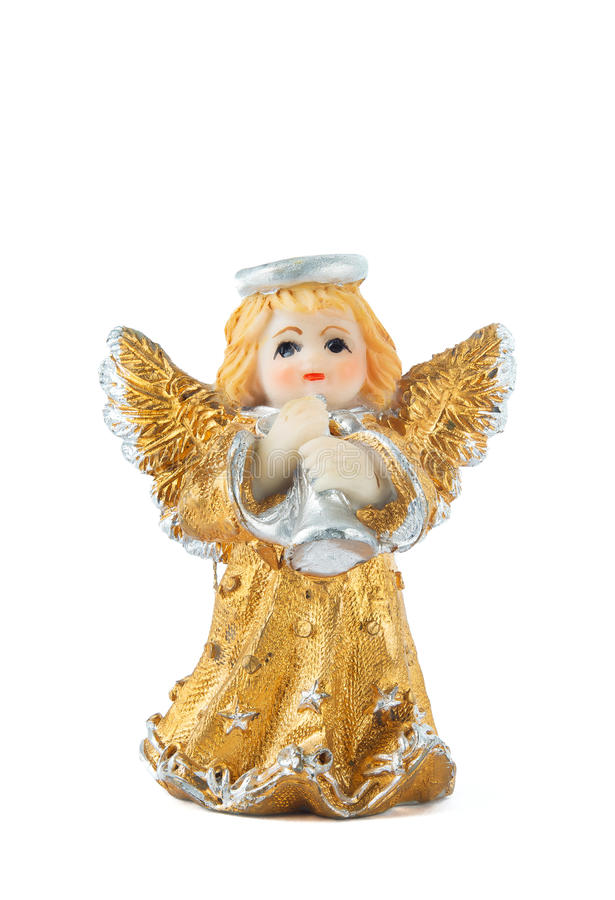 Little Gold Angel Statue. A little miniature statue of a colorful angel with wings and halo, playing the trumpet royalty free stock image